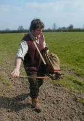 Me using a very old seeding tool known as a fiddle.